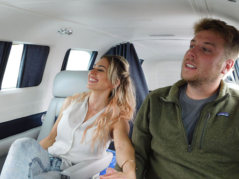 husband-and-wife-enjoying-a-comfortable-private-charter-flight